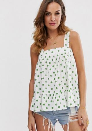 Witte top met groene stippen