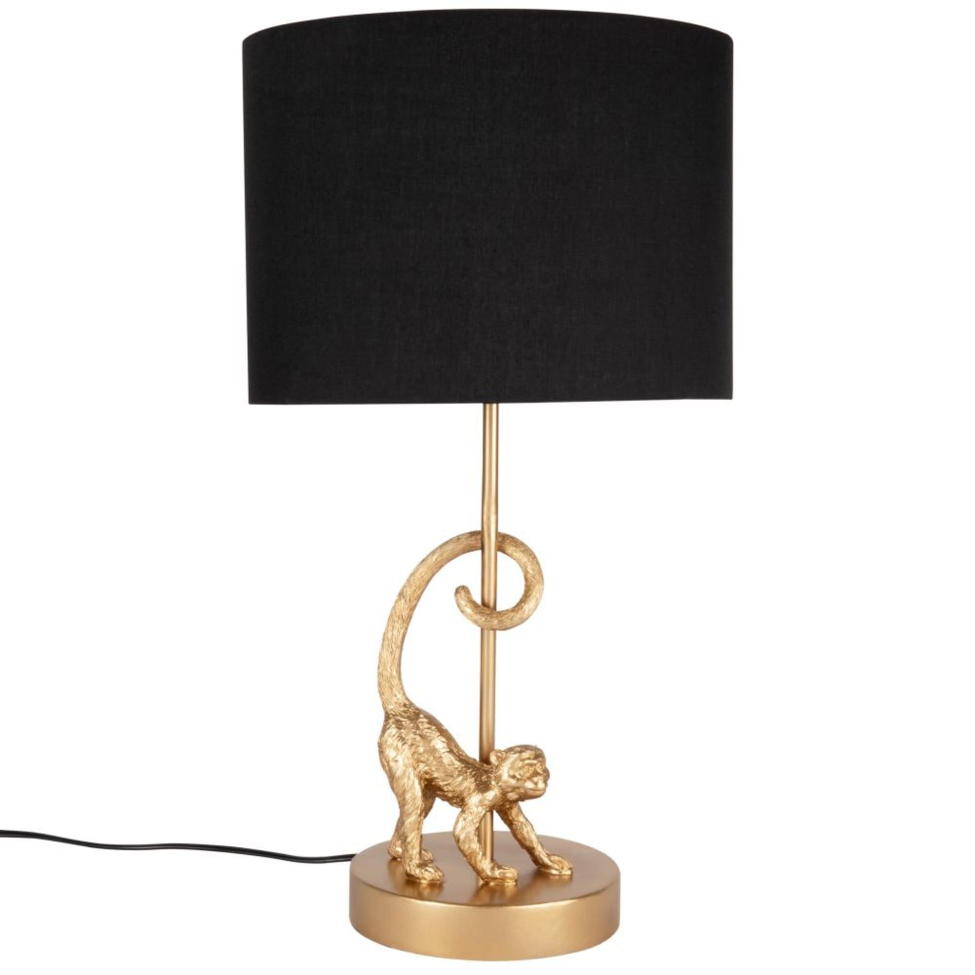 Lampe singe doré