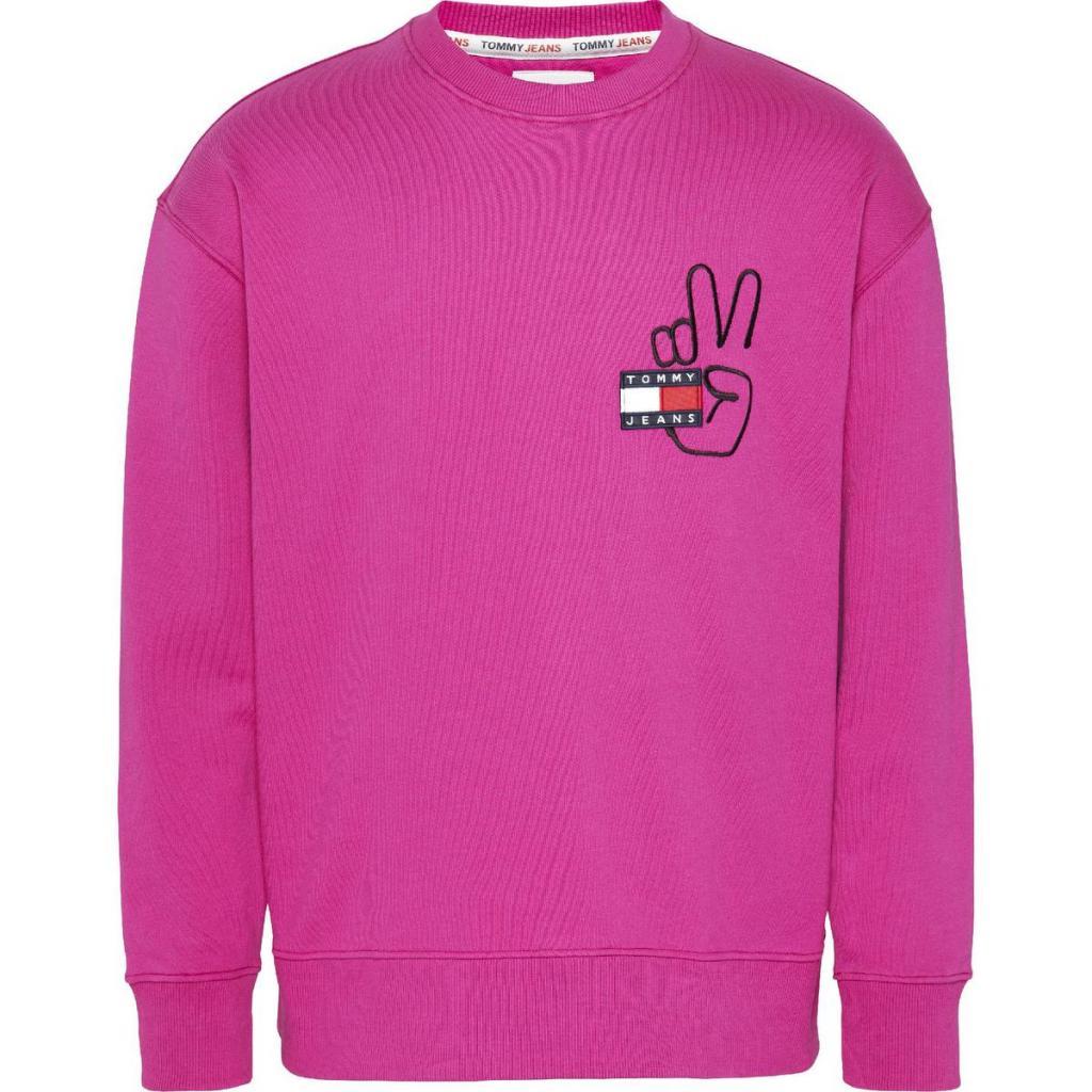 Roze sweater met een vredevolle boodschap (89,90 euro), van Tommy Jeans.