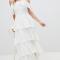 Ivoorkleurige maxi-jurk met cold shoulder