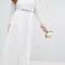 Witte maxi-jurk met crop top en lange kanten mouwen