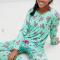 Muntgroene pyjama met piñata's en doodskoppen