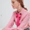 Roze blouse met fuchsia strik en hartjesapplicaties