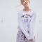 Lilakleurige pyjamaset met opschrift 'Coffee o' clock'