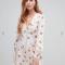 Witte mini-jurk in jacquard met pofmouwen