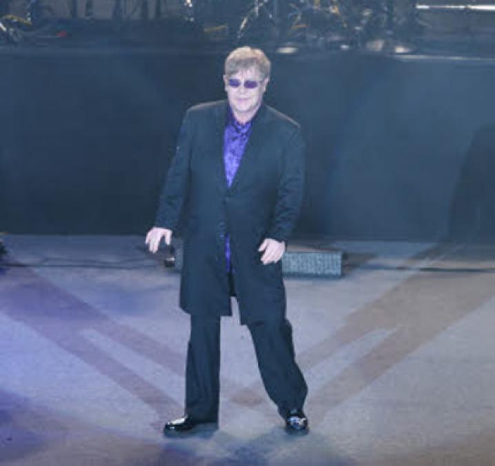 Elton John = Reginald Dwight